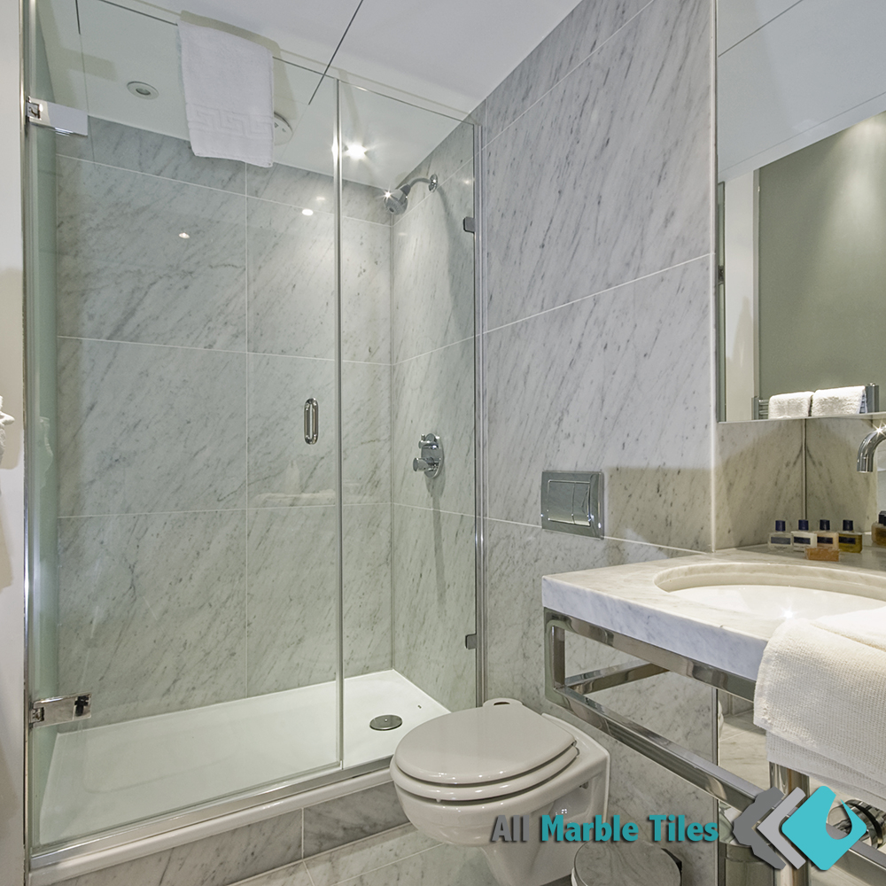 bathroom design with carrara marble tile
